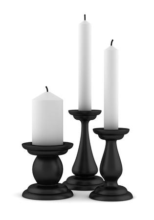 drie zwarte kandelaars met kaarsen geïsoleerd op witte achtergrond