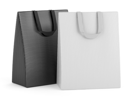 two blank shopping bags isolated on white background photo