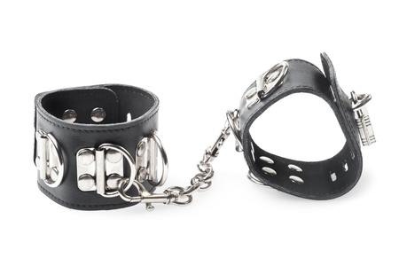 black leather handcuffs isolated on white background Stock Photo - 18012667