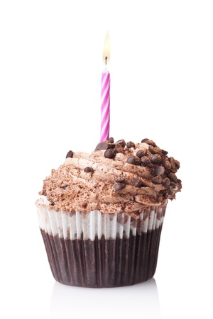 chocolate cupcake with candle isolated on white background photo