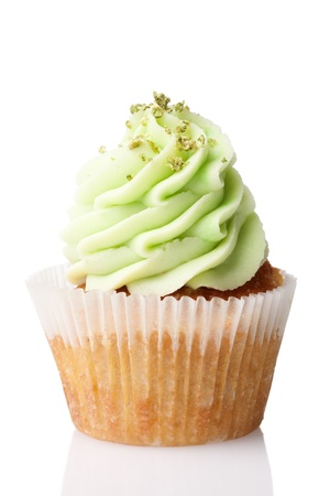 cupcake with green cream isolated on white background photo