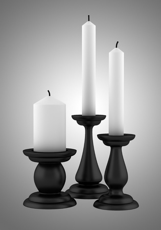 candle holders: three black candlesticks with candles isolated on gray background