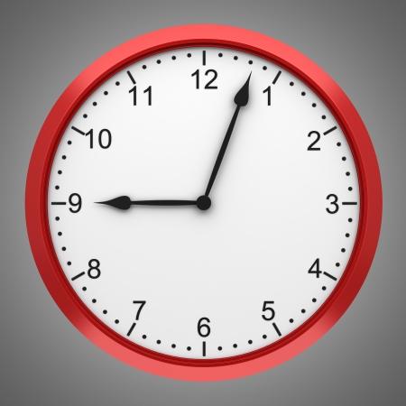 reloj de pared: redondo rojo reloj de pared aislada sobre fondo gris Foto de archivo