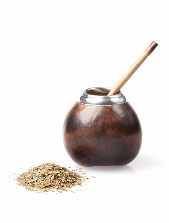 calabash and bombilla with yerba mate isolated on white background photo