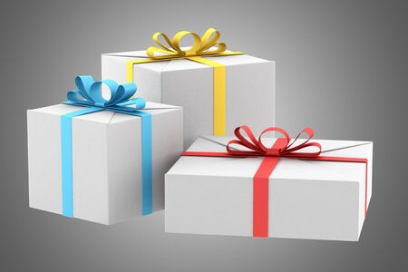 three white gift boxes with color ribbons and bows isolated on gray background photo