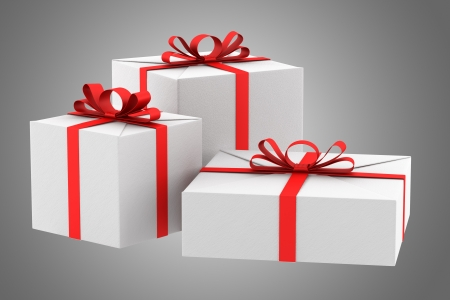 three white gift boxes with red ribbons and bows isolated on gray background photo