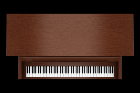 upright piano: top view of brown upright piano isolated on black background