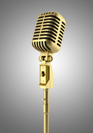 golden vintage microphone isolated on gray background photo