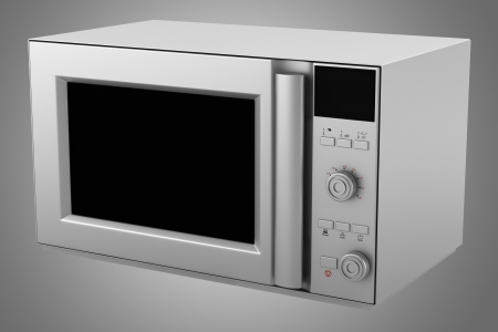 microwave oven isolated on gray background photo