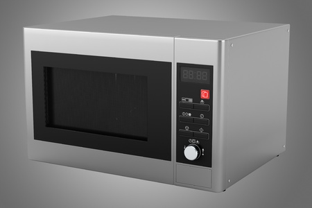 grey microwave oven isolated on gray background photo