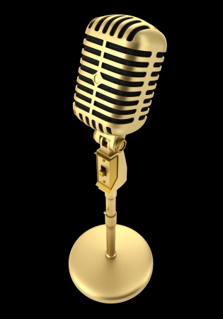 golden vintage microphone isolated on black background