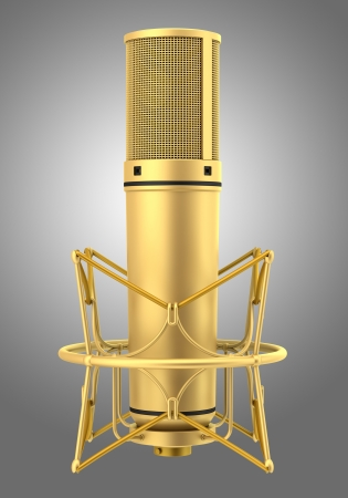 golden studio microphone isolated on gray background photo