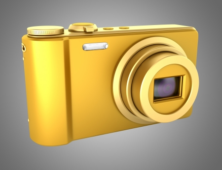 compact camera: golden point and shoot photo camera isolated on gray background