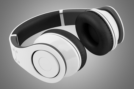 white and black wireless headphones isolated on gray background Stock Photo - 21060414
