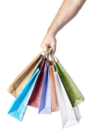 male hand holding shopping bags isolated on white background photo