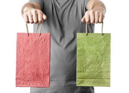 man holding two shopping bags isolated on white background. choice concept photo