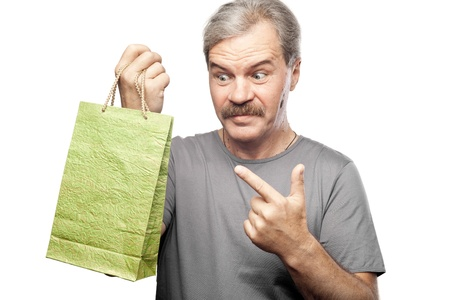 surprised mature man holding shopping bag isolated on white background photo