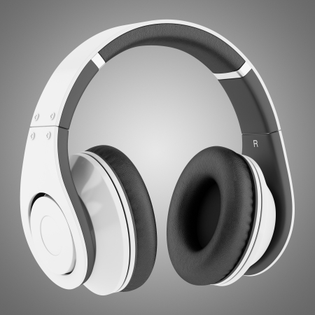 white and black wireless headphones isolated on gray background photo