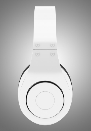 side view of white and black wireless headphones isolated on gray background photo