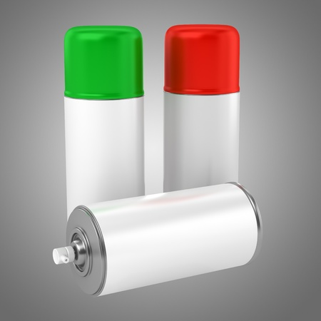 color spray cans isolated on gray background photo