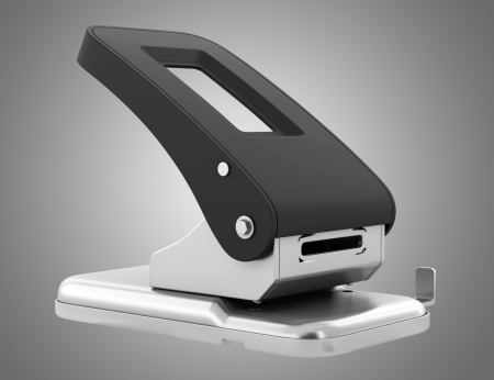 hole punch: paper hole punch isolated on gray background