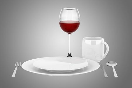 table setting with glass of red wine isolated on gray background photo
