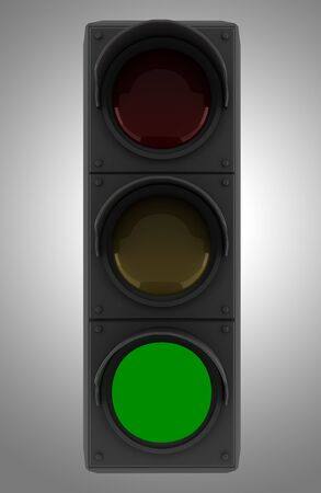 green traffic light isolated on gray background photo