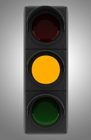 yellow traffic light isolated on gray background photo