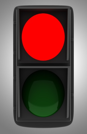 red traffic light isolated on gray background photo