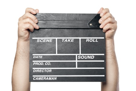 two male hands holding movie production clapper board isolated on white background photo