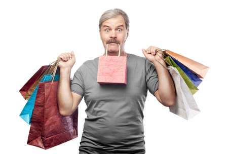 surprised mature man holding shopping bags isolated on white background photo