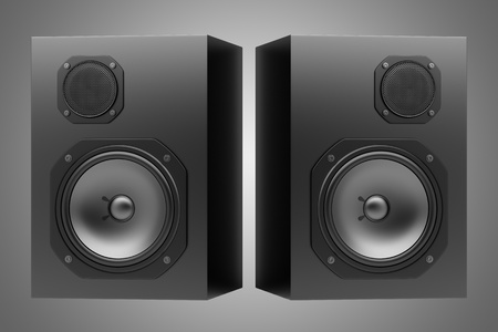 two black audio speakers isolated on gray background photo