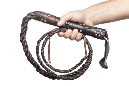 male hand holding brown leather whip isolated on white background photo