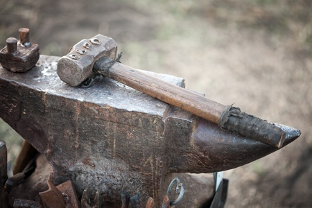 hammer on blacksmith anvil   photo