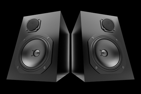 two black audio speakers isolated on black background photo
