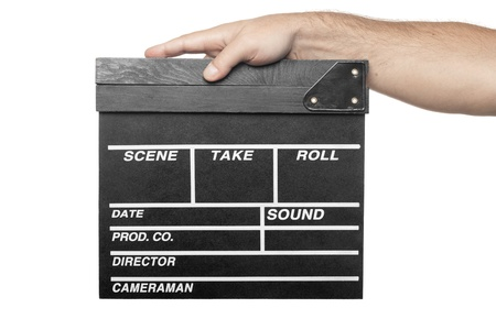male hand holding movie production clapper board isolated on white background photo