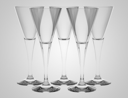 empty champagne glasses isolated on gray background photo