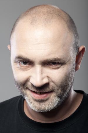 portrait of gloomy man isolated on gray  photo