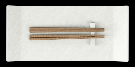 top view of empty sushi dish with chopsticks isolated on black background photo