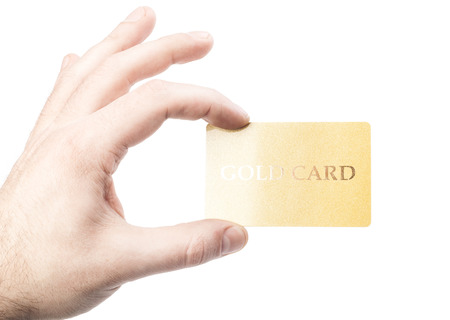 male hand holding gold credit card isolated on white background photo