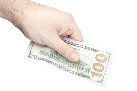 male hand holding 100 dollars isolated on white background photo