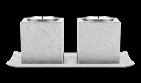 black metallic background: two metallic candlesticks with candles isolated on black background