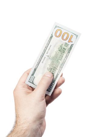 male hand holding 100 dollars isolated on white background photo