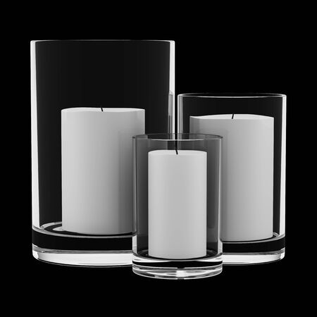 candle holders: three glass candlesticks with candles isolated on black background