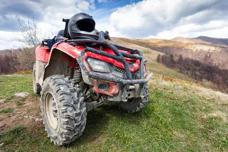 ATV on mountains landscape on a sunny day Standard-Bild