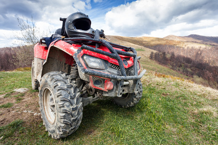 quad: ATV on mountains landscape on a sunny day Stock Photo