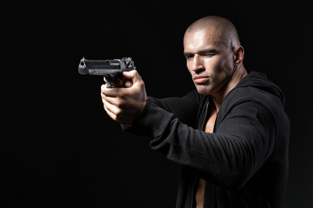 man shooting gun isolated on black background photo