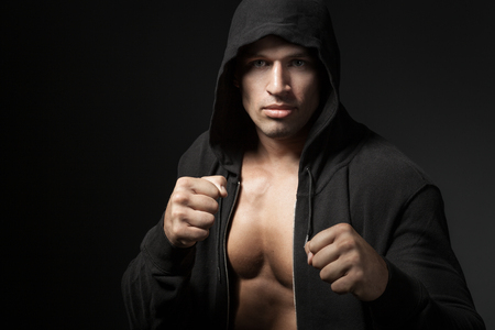 strong man fighter portrait isolated on black background photo