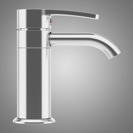 modern chrome faucet isolated on gray background photo
