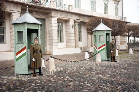BUDAPEST, HUNGARY - DECEMBER 28: Ceremonial guard at the Presidential Palace. They guard the entrance of the Sandor Palace - official residence of Hungarian President in Budapest. December 28, 2013 in Budapest, Hungary.